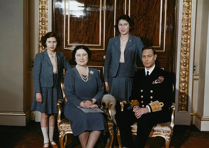 Princess Elizabeth, the Queen Mother, Princess Margaret and King George VI all in blue.