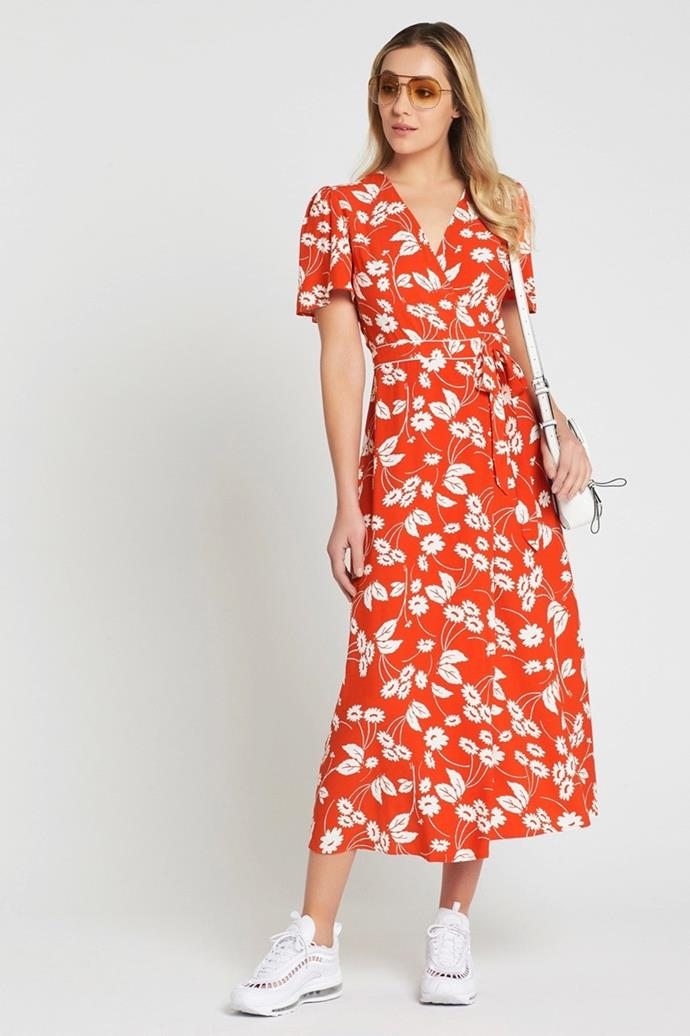 """Rixo London Dress, $495 at [Mode Sportif](https://www.modesportif.com/shop/product/rixo-london-shauna-short-sleeved-wrap-dress-in-abstract-daisy/