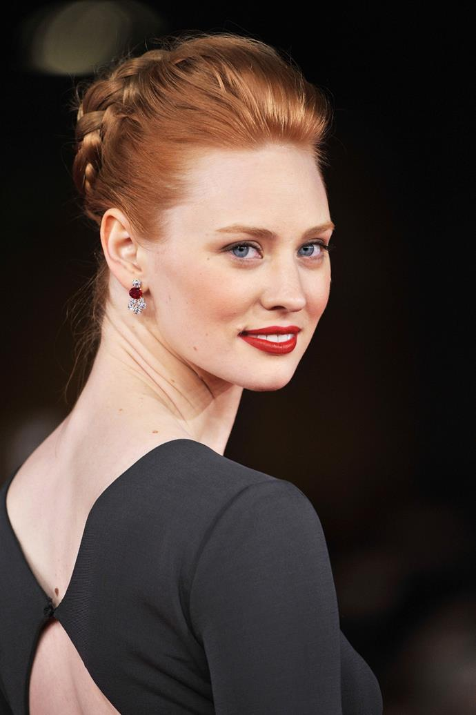 **Deborah Ann Woll** <br><br> She plays a feisty newbie vampire on <em>True Blood</em>, but Deborah Ann Woll's matching brows and tonal lip and cheek shades make the glossy orange more ladylike.