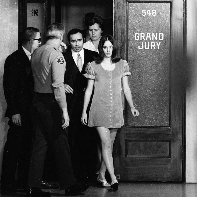 Susan Atkins leaving the grand jury room at the Manson trials.