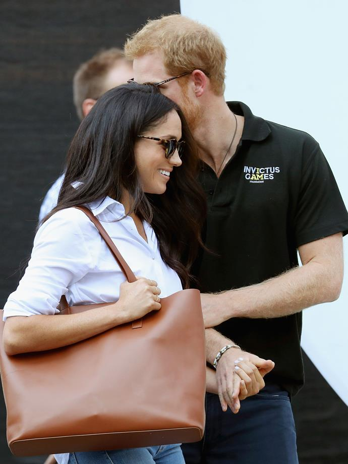 In some of their first ever photos as a then-covert couple, Prince Harry did a pretty poor job at keeping their relationship low-key, grabbing onto Markle's arm and pressing his cheek to her head.