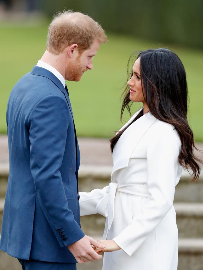 Look at this loving glanced exchanged between the newly-engaged pair.