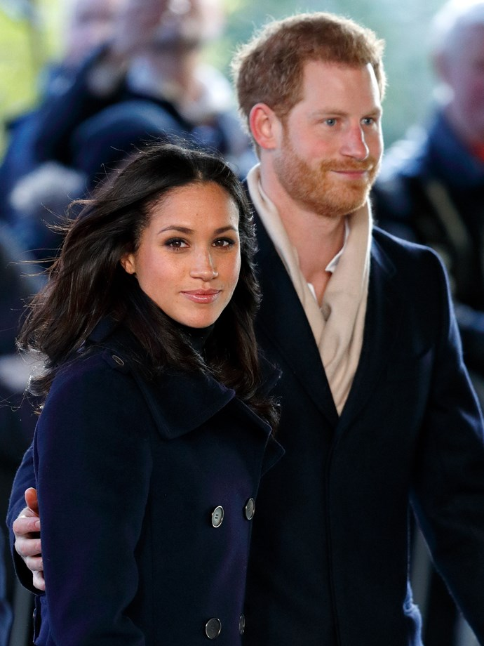 Just as common is the ever popular 'hand on the small of Meghan's back' move.