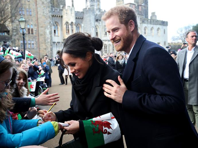 Here, the ever-supportive Harry supported Meghan when she came up against a throng of fans.