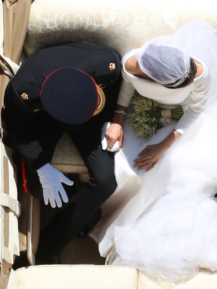 That, or this candid overhead glimpse at some post-nuptial PDA.