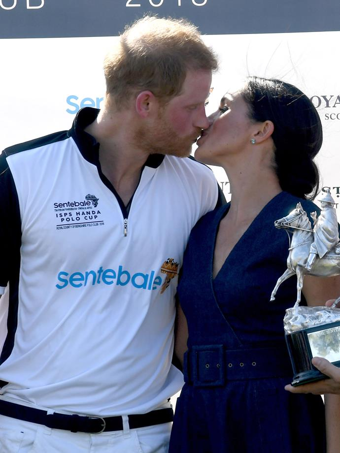 And gives him a huge, congratulatory kiss.