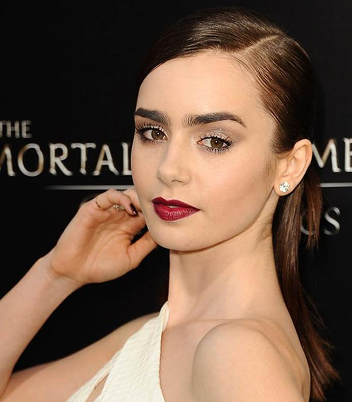 **Side Parting** <br><br> **Red Carpet:** Let's call Lily Collins' style the hair equivalent of the Diane Von Furstenberg wrap dress. Gather a chunk of hair from either side of the face, wrap it around and fasten. BYO bobby pins. Voila!