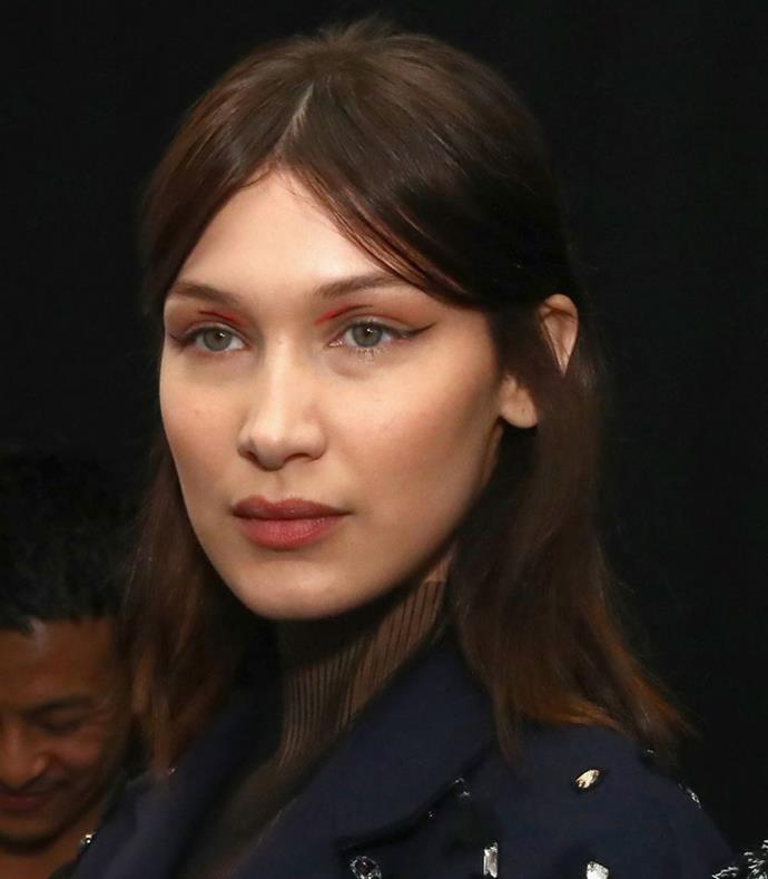 """**Centre Parting Half-Up** <br><br> **Runway:** """"It's all about freeing up the hair"""" explains hairstylist Holli Smith for Jason Wu. We saw a soft middle parting and a slight teasing of the hair to create volume."""