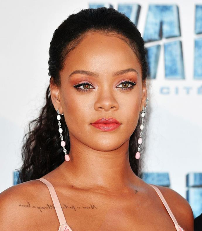 **Simple Low Half-Up** <br><br> **Red Carpet:**With simple brushed back hair, Rihanna is the picture of laidback pretty.