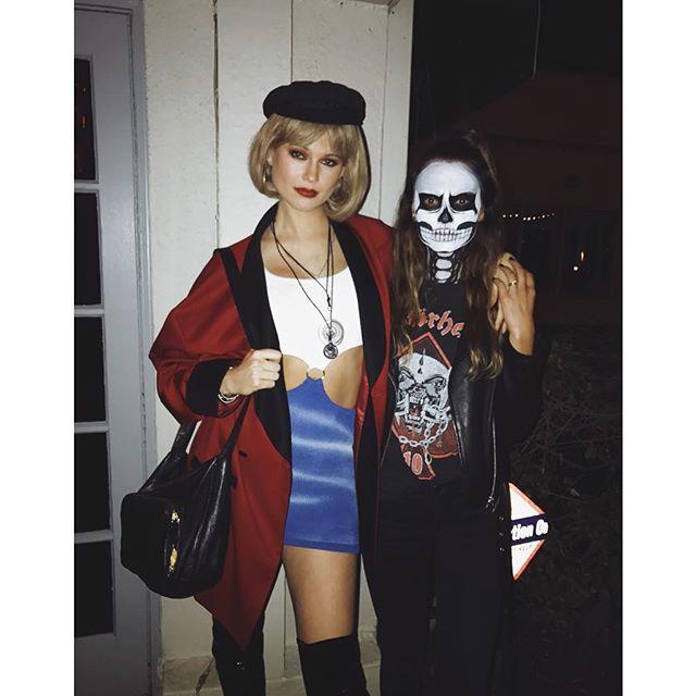 "Victoria's Secret Angel Behati Prinsloo channeled Julia Roberts' character Vivian in the 1990 film *Pretty Woman* for Halloween 2016.  <br><br> *Image: [@behatiprinsloo](https://www.instagram.com/p/BMR_t3vBgbk/?taken-by=behatiprinsloo|target=""_blank"")*"