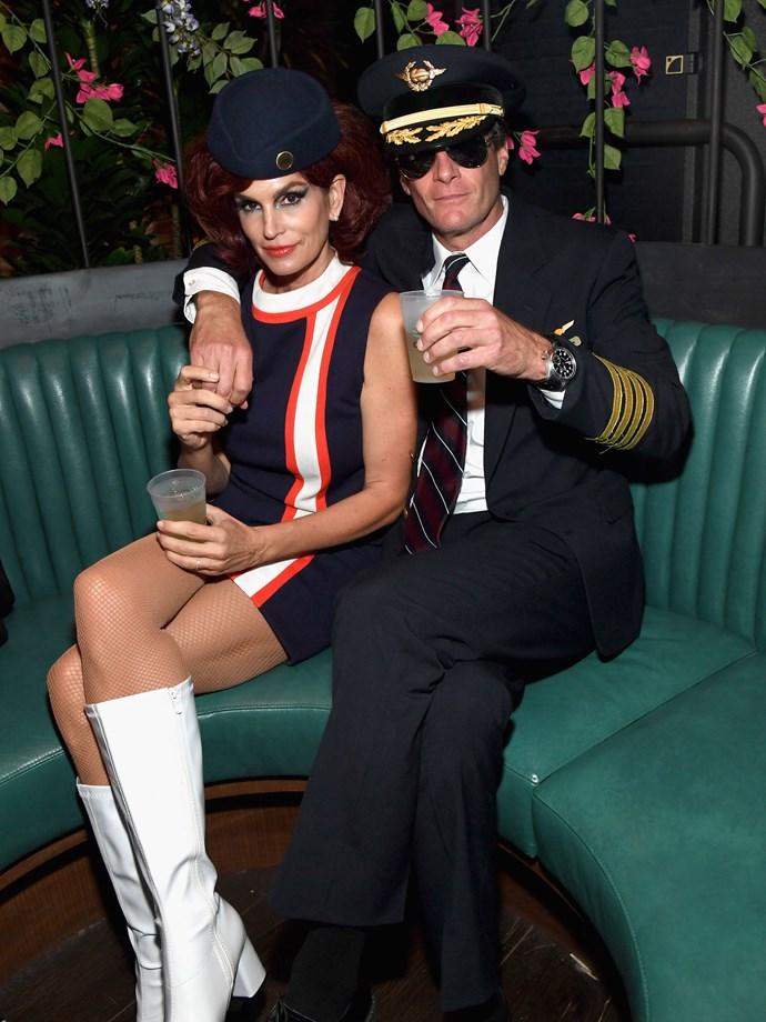 Cindy Crawford as a retro air stewardess.