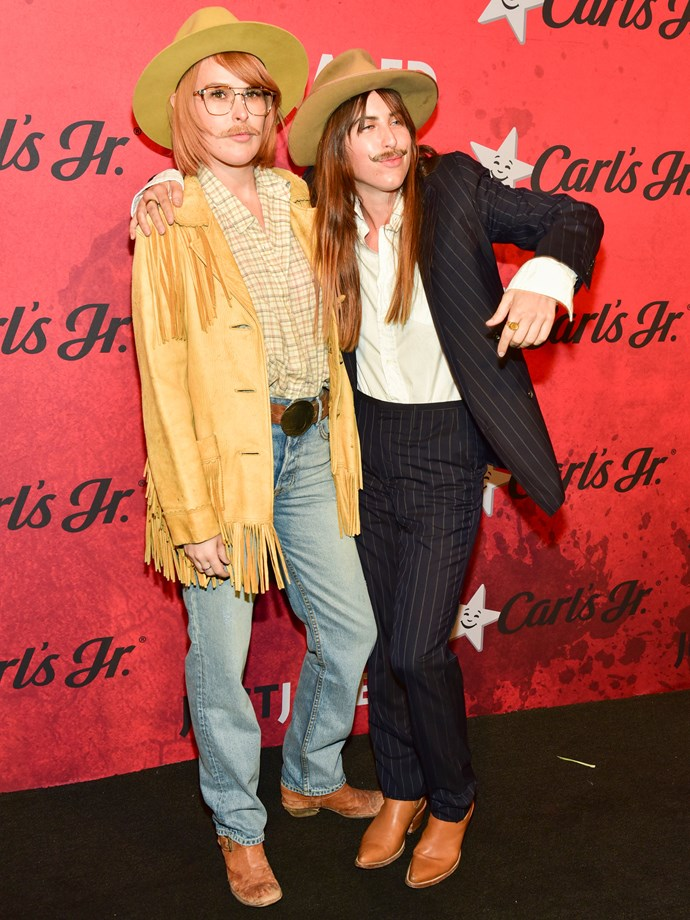 Scout and Rumer Willis as moustache-donning cowboys.