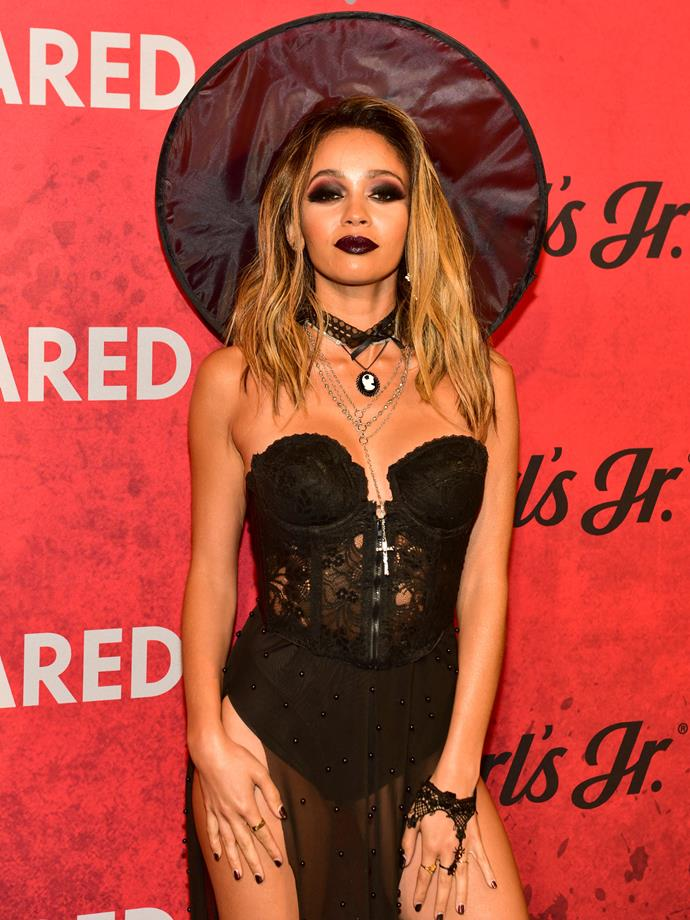 Vanessa Morgan as a witch.