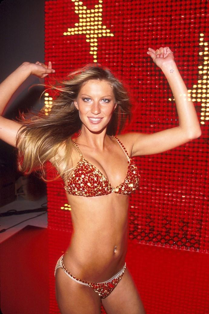 ***Red Hot Fantasy Bra (2000)*** <br><br> **Model:** Gisele Bündchen <br> **Detail:** Red satin, diamonds and rubies <br> **Cost:** $15 million