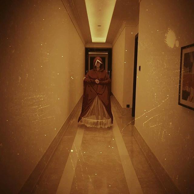 Lindsay Lohan as a Handmaid from *The Handmaid's Tale*.