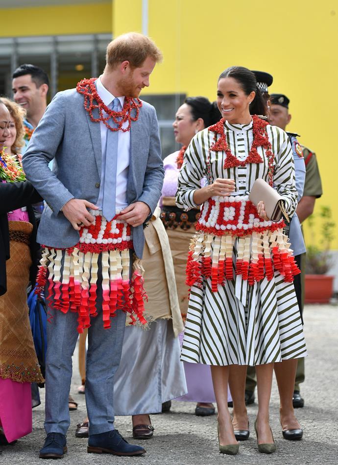 Martin Grant striped cotton dress: **$1,595** <br> Prada Saffiano nude clutch: **$1,700** <br> Manolo Blahnik BB Pumps: **$936** <br><br> **Total cost: *$4,231***