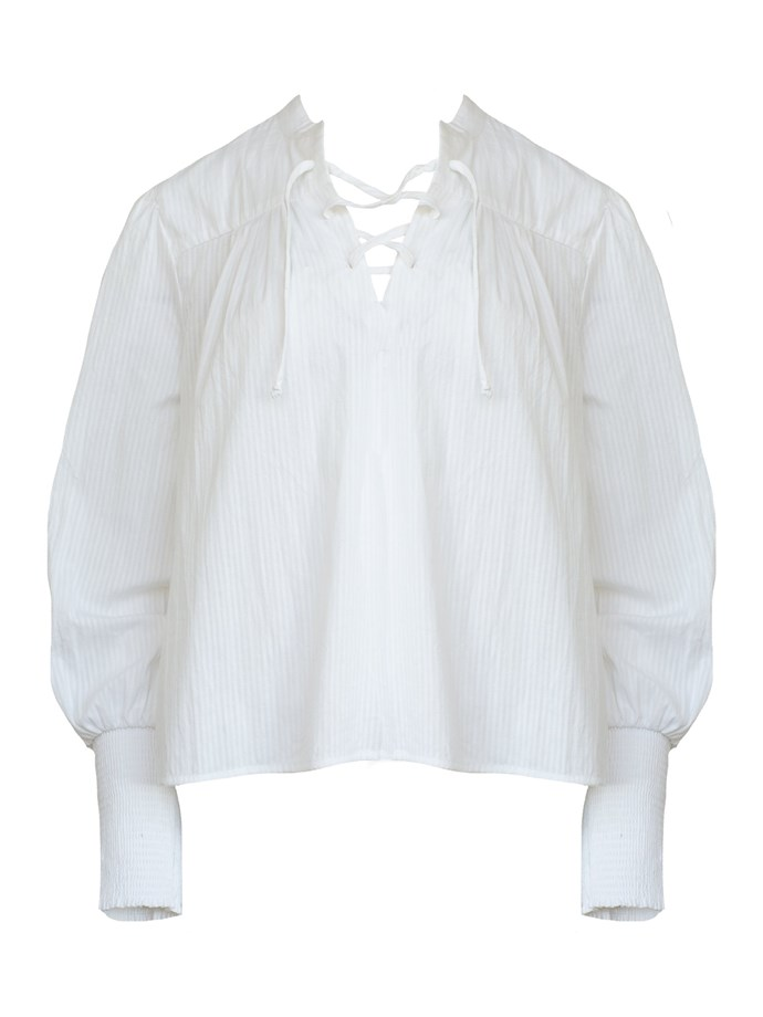"""Pin tuck blouse by Frame Denim, $395 at [The Undone](https://www.theundone.com/collections/tops/products/mandarin-pin-tuck-top-white