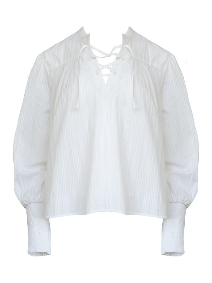 """Pin tuck blouse by Frame Denim, $395 at [The Undone](https://www.theundone.com/collections/tops/products/mandarin-pin-tuck-top-white target=""""_blank"""" rel=""""nofollow"""")."""
