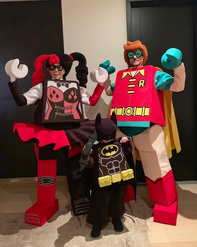 Justin Timberlake and Jessica Biel with son Silas, as characters from *The Lego Batman Movie*.