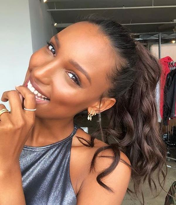**Ponytail** <br><br> The key to Jasmine Tookes ponytail looking more glam-girl and less surfer-girl is the <em>height</em> that she's managed around the head. Work with the beachy waves you have and apply a texturising powder to the locks to give the hair body, before you secure with an elastic.