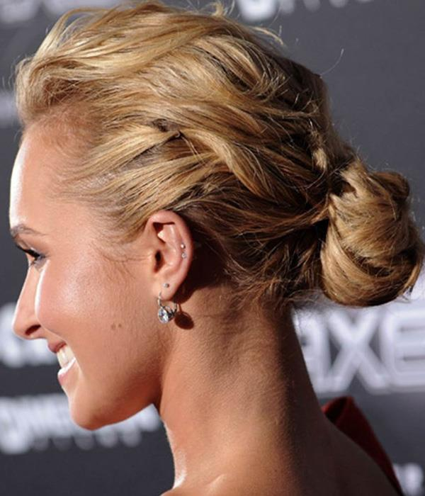 **Low bun** <br><br> Start the low bun process with the backcomb instructions and then follow through by loosely pinning chunks of hair, in circles, at the nape of the neck. When you're done, the idea is to look like Hayden Panettiere.