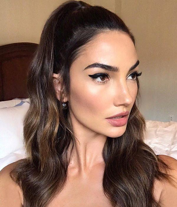 **Half-up look** <br><br> The easiest way to tame a wild beach-hair day is to take two pieces of your locks one from each side of your head—and secure them at the back of the head like a halo, just like the angel that is Lily Aldridge. Just remember to detangle before you secure, because this style can often end up in knots.