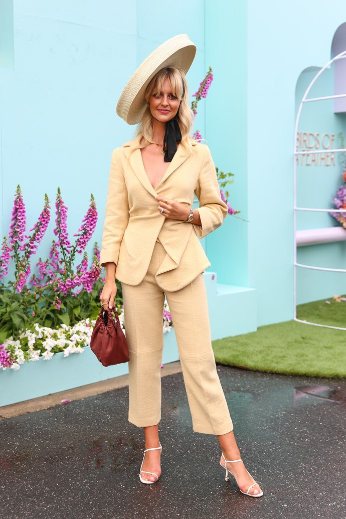 **Elle McClure, Culture Director:** Saasha Burns on Lexus Melbourne Cup Day—her tonal Jacquemus suit was chic and understated and her mini Row bag and bowed hat were the perfect on-trend statement accessories.