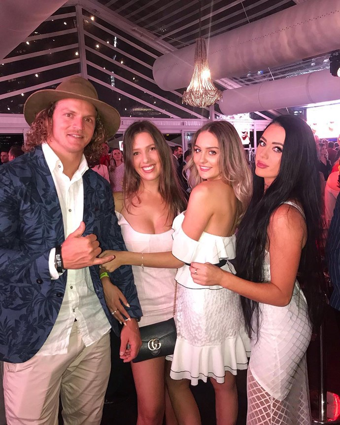 Nick 'The Honey Badger' Cummins poses with fans at the Melbourne Cup.