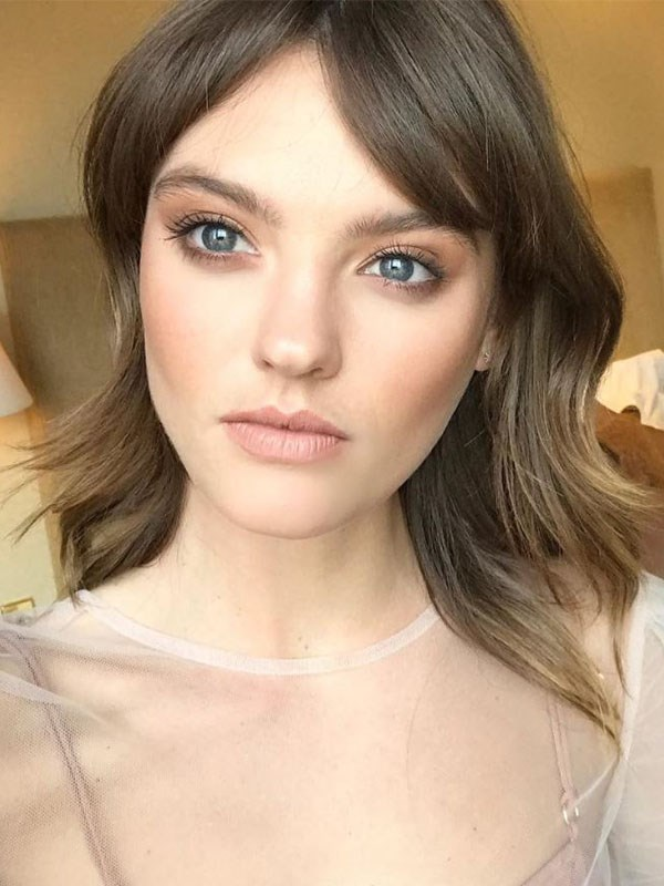 """**Heart:** """"For heart faces, try side-sweeping, layered fringes that hit the eyebrow and angle down towards the side of the face. This kind of fringe will draw attention to the eyes and balance the face,"""" Scandizzo said."""