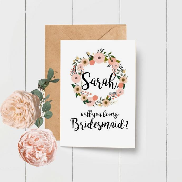"***A simple card***<br><br> If your 'maid lives out of town, nothing is better than receiving an ultra-sweet—ultra-personalised—card in the mail. <br><br> Card, $4.50 by [The Paper Bird Cage](https://www.thepaperbirdcage.com.au/listing/500962313/floral-wreath-personalised-will-you-be|target=""_blank""