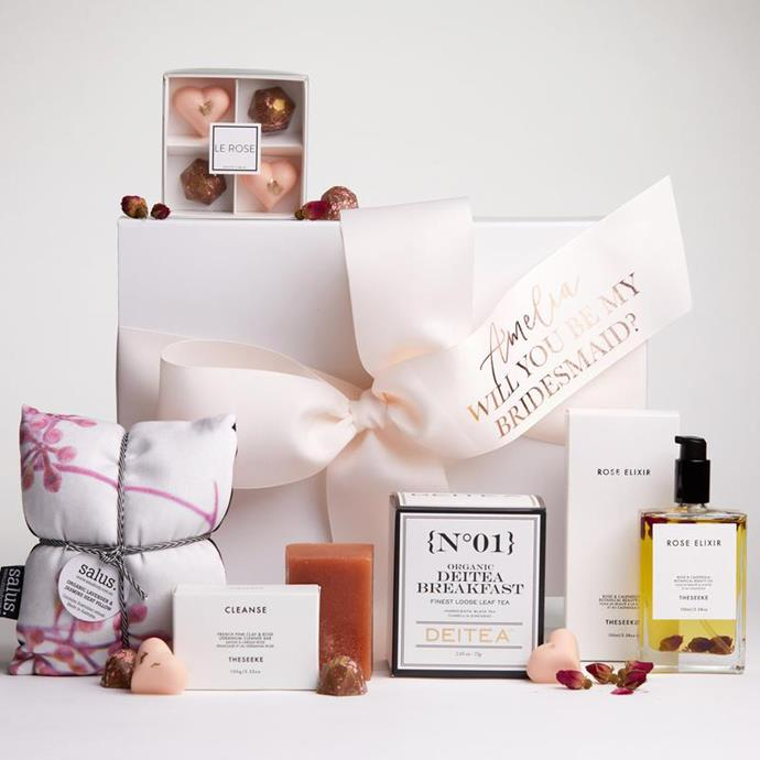 "***A fun hamper***<br><br> Why give her one gift when you can give her many? Le Rose's gift hampers come with lots of sweet treats, including handmade chocolates, luxurious beauty products and organic teas—all tied up with a ribbon that asks, ""will you be my bridesmaid?"" Send one over to her in the mail and wait for the tearful phonecall.<br><br> Hamper, $145 by [Le Rose](https://lerose.com.au/collections/for-her/products/sweet-elixir