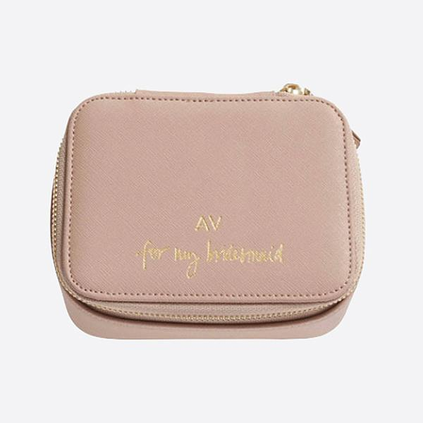 "***A keepsake box***<br><br> With beautiful lettering on the lid—""for my bridesmaid""—gift her with a beautiful keepsake box that she can keep all her little momentos from the day in.<br><br> Keepsake box, $99.95 by [The Daily Edited](https://www.thedailyedited.com/taupe-keepsake-box