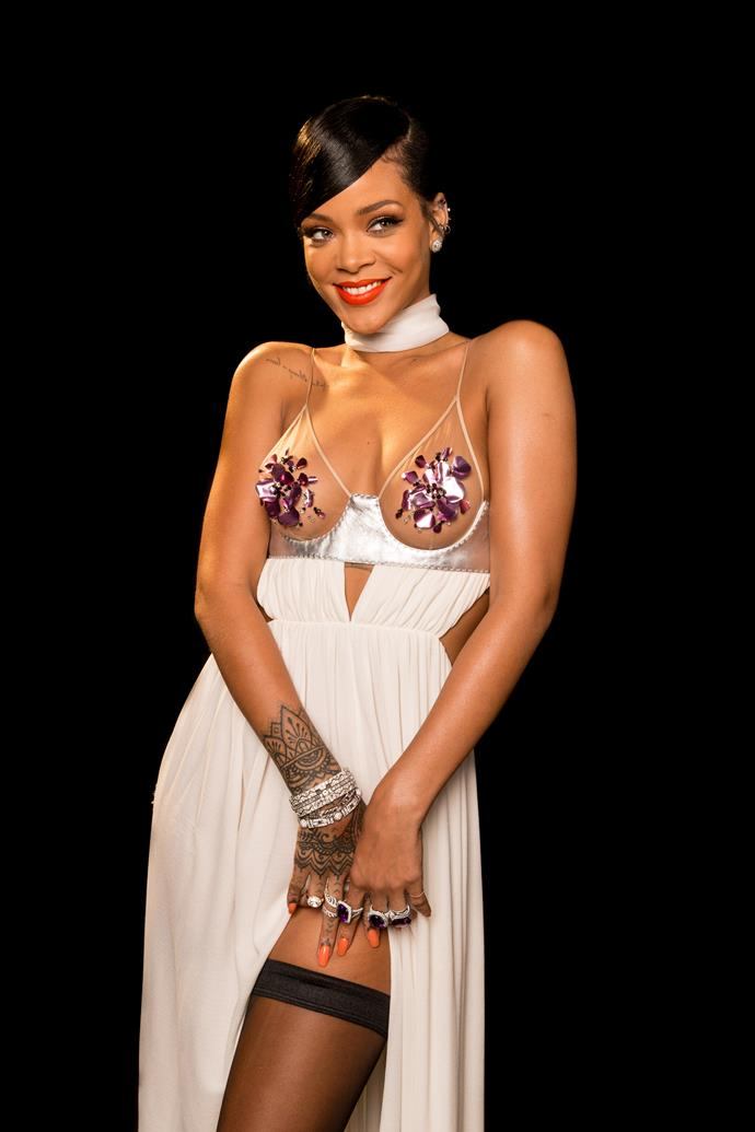 **2014:** Attending an amFAR Gala in Los Angeles wearing barely-there Tom Ford.