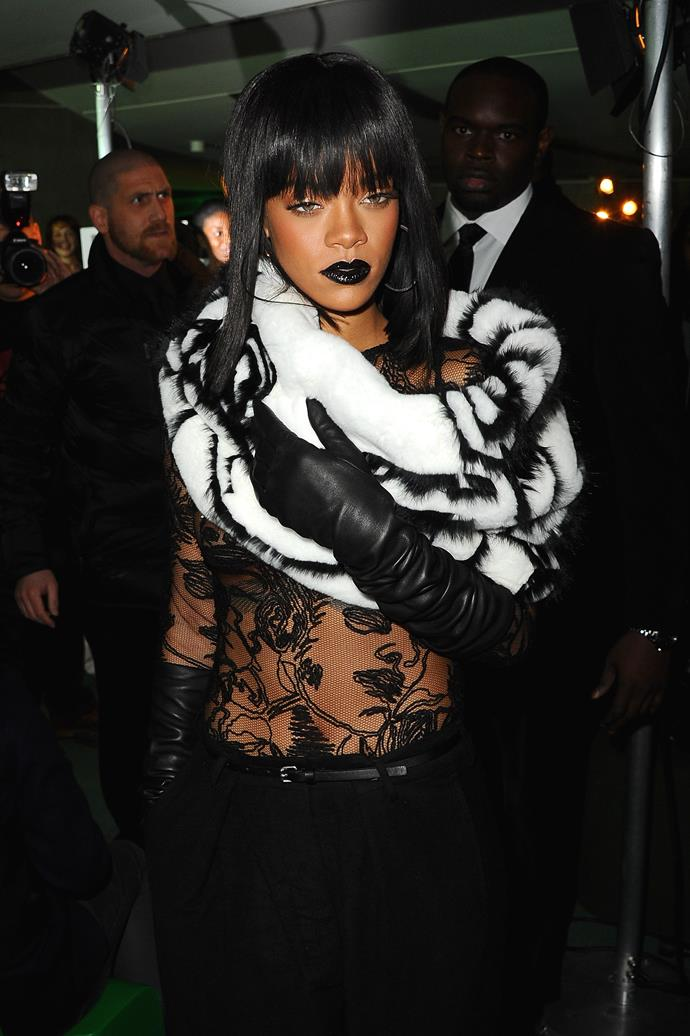 **2014:** Front row at the Jean Paul Gaultier show at Paris Fashion Week wearing an entirely see-through shirt.