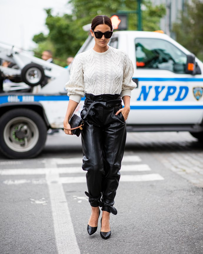 Lily Aldridge's white sweater and jeans combo was decidedly low-key, but the leather trousers (and gold pop on her Givenchy bag) kept it cool.