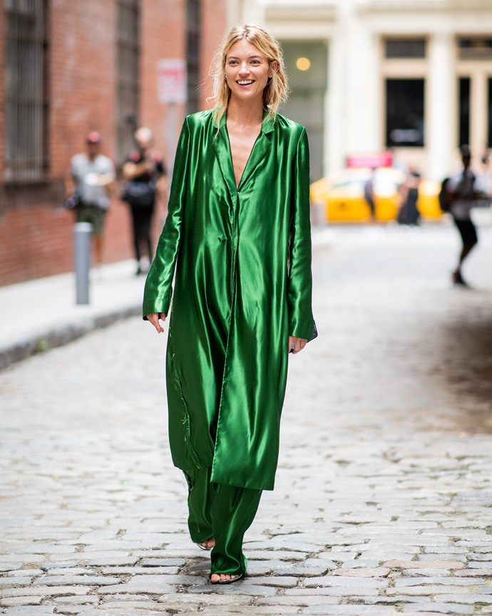 Martha Hunt is no stranger to a statement look, and we're *very* here for this silky emerald romper.