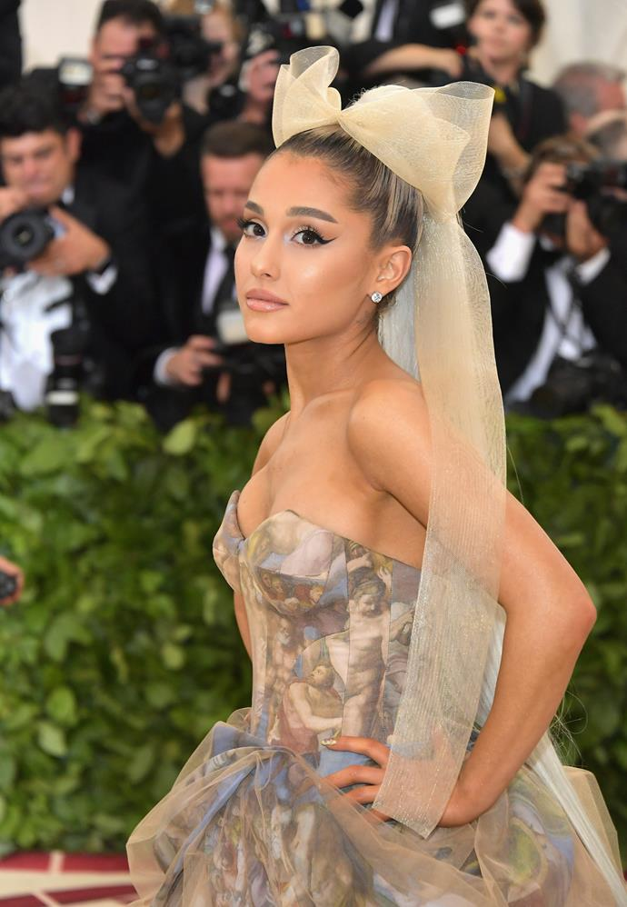 **May 2018**<br><br>  For her first-ever Met Gala in May 2018, Grande opted for an exaggerated winged eyeliner and giant bow, complete with glossy, golden makeup.