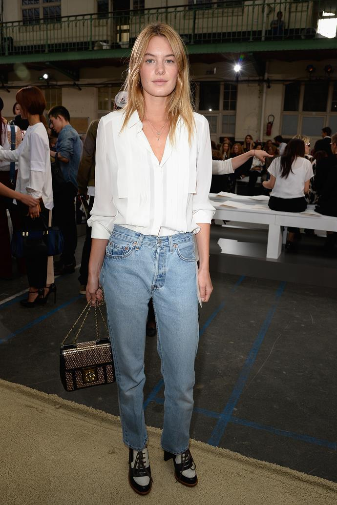 One-time Angel Camille Rowe's street-style looks are effortless—and attending a Chloé show, she proved that a jeans and shirt combo is *far* from monotonous.