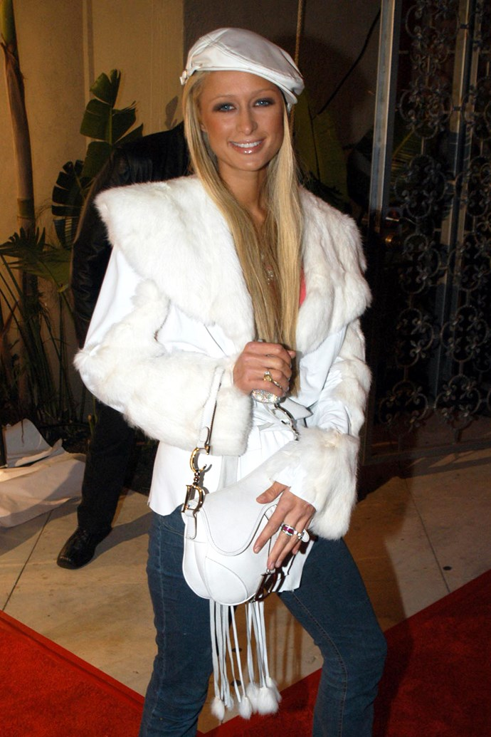 Hilton pictured with a Christian Dior Saddle Bag in 2002.