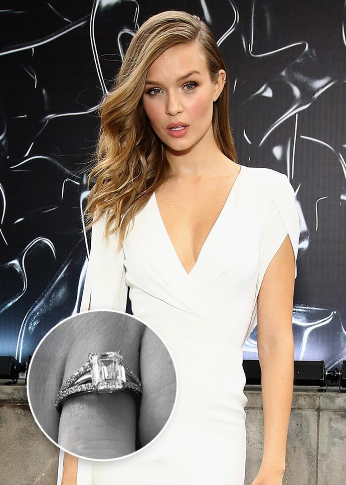 """**Josephine Skriver**<br><br>  Although the centre piece of Josephine Skriver's engagement ring is more traditional—an emerald-cut diamond—the band is a little more unconventional. The stone is mounted on a """"split-shank"""" pavé band, which seems to sit on *another* plain platinum band."""