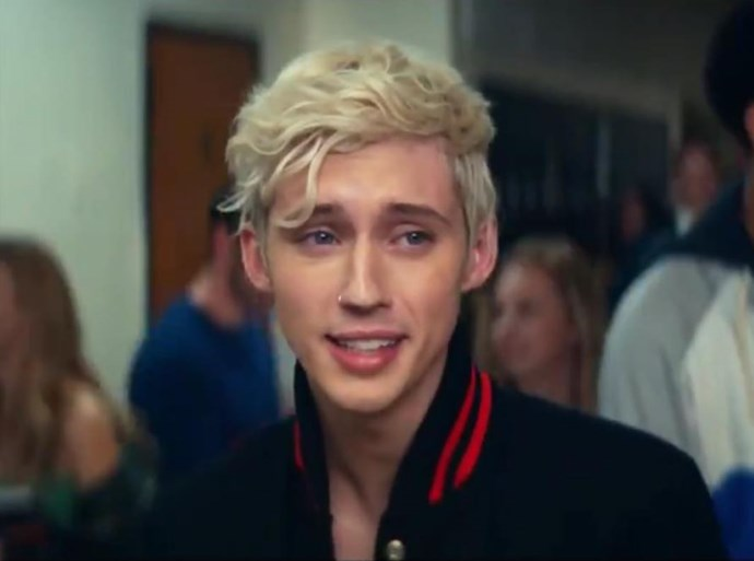Singer Troye Sivan appears in the *Mean Girls* portion of the clip.