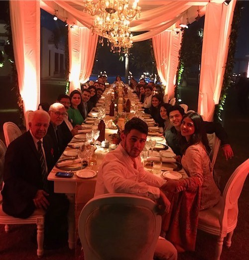 "***November 23:*** On the same day that she posted the arrival selfie, Chopra shared a photo of herself and her fiancée sharing Thanksgiving dinner with her Indian family. <br><br> *Image: [@priyankachopra](https://www.instagram.com/p/Bqfryq6Hxvd/|target=""_blank""