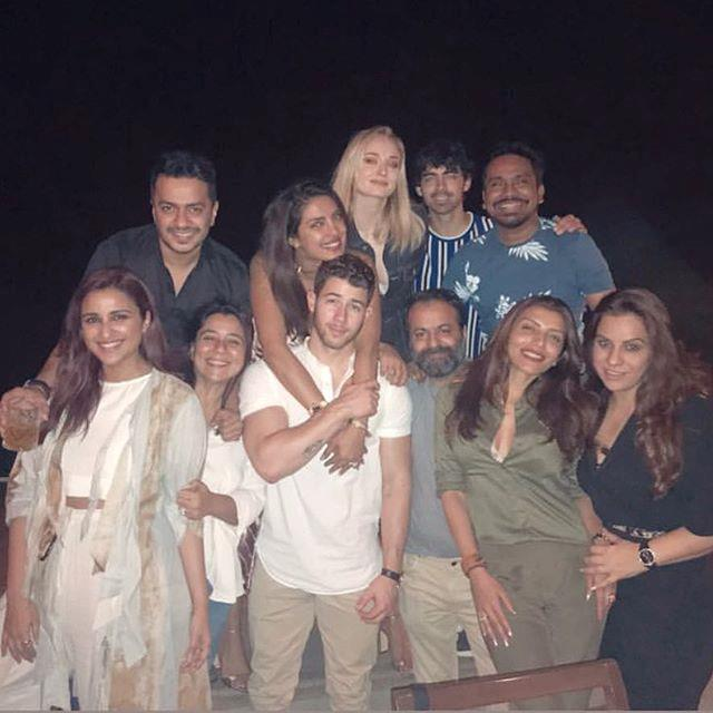 "***November 28:*** Chopra shared a sweet snap of herself and Jonas with her family and friends, as well as Joe Jonas and Sophie Turner. <br><br> *Image: [@priyankachopra](https://www.instagram.com/p/BqsT-kfHaHh/|target=""_blank""