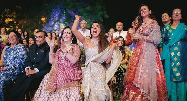 "***December 1, 2018:*** Chopra and her family look on as Jonas and his side of the wedding party put on a show. <br><br> *Image: [@priyankachopra](https://www.instagram.com/p/BqsT-kfHaHh/|target=""_blank""