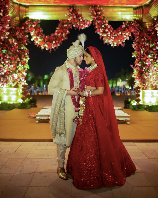 "***December 2, 2018:*** The bride and groom tied the knot a second time in a traditional Indian ceremony on the Sunday following their Saturday wedding extravaganza. Jonas called it, ""the happiest day of my life""."