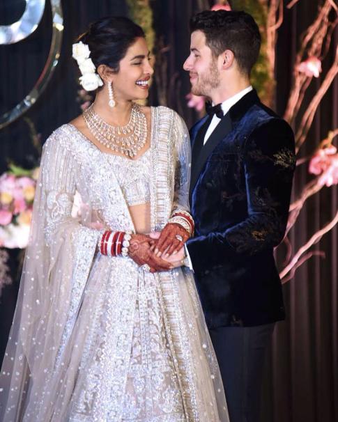 ***December 2, 2018:*** Chopra and Jonas at their wedding reception.