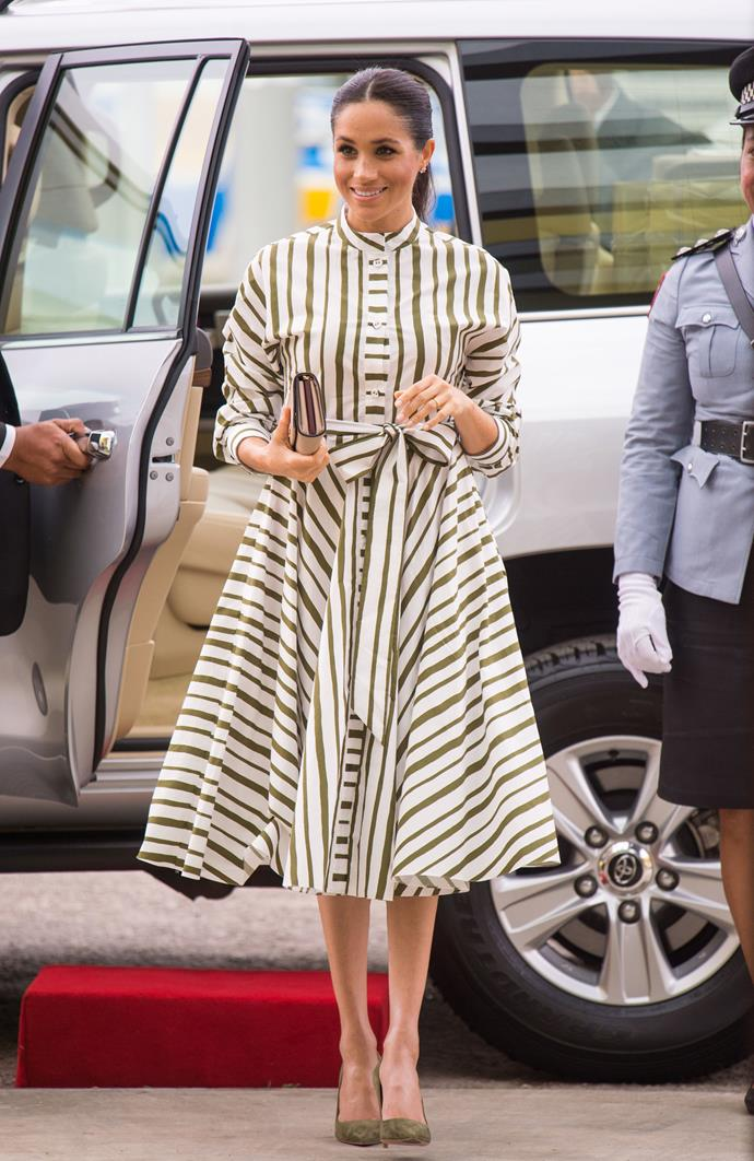 ***Visiting Tongan Prime Minister***<bR><br> Striped cotton dress by Martin Grant: $1,595 <br> Saffiano nude clutch by Prada: $1,700 <br> 'BB' Pumps by Manolo Blahnik: $936 <br> Bee chic white quartz earrings by Birks: $468<br><br> *Total*: $4,699