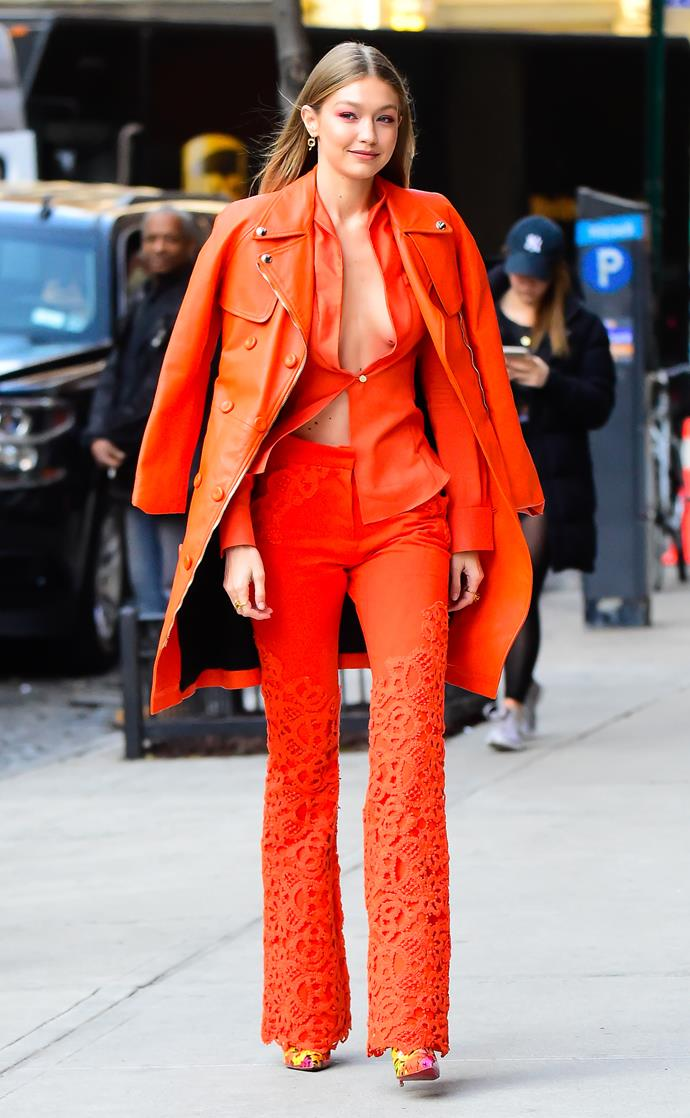 Gigi Hadid in head-to-toe orange in New York City, wearing a custom Ronald Van Der Kemp look.