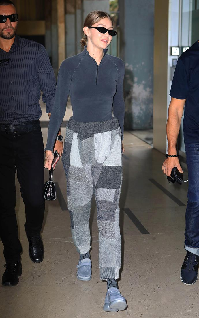 Gigi Hadid wearing luxe sportswear and cashmere patchwork track pants in Milan, Italy, on September 19, 2018.