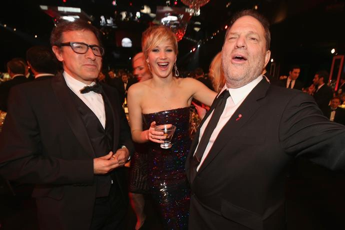 From left: Director David O. Russell, Lawrence and Weinstein in 2014.